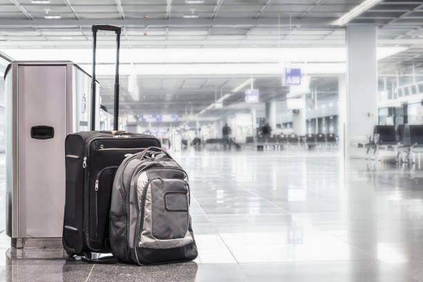 Unattended cabin case and abackpack at the boarding gates of an airport. stock photo