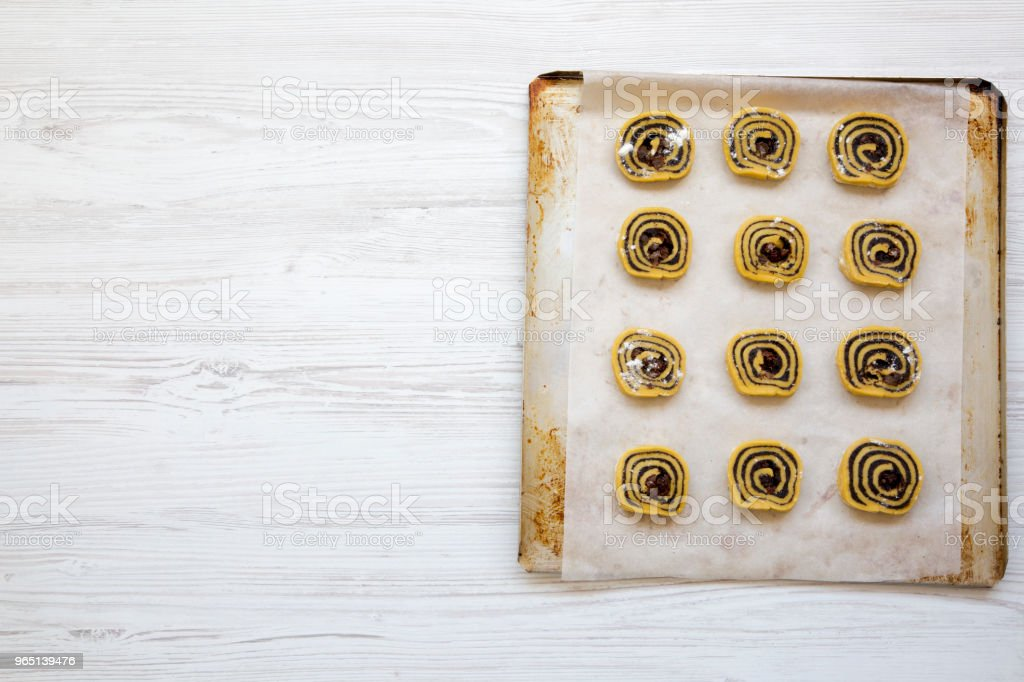 Unbaked cookies on a baking sheet, top view. Copy space. zbiór zdjęć royalty-free