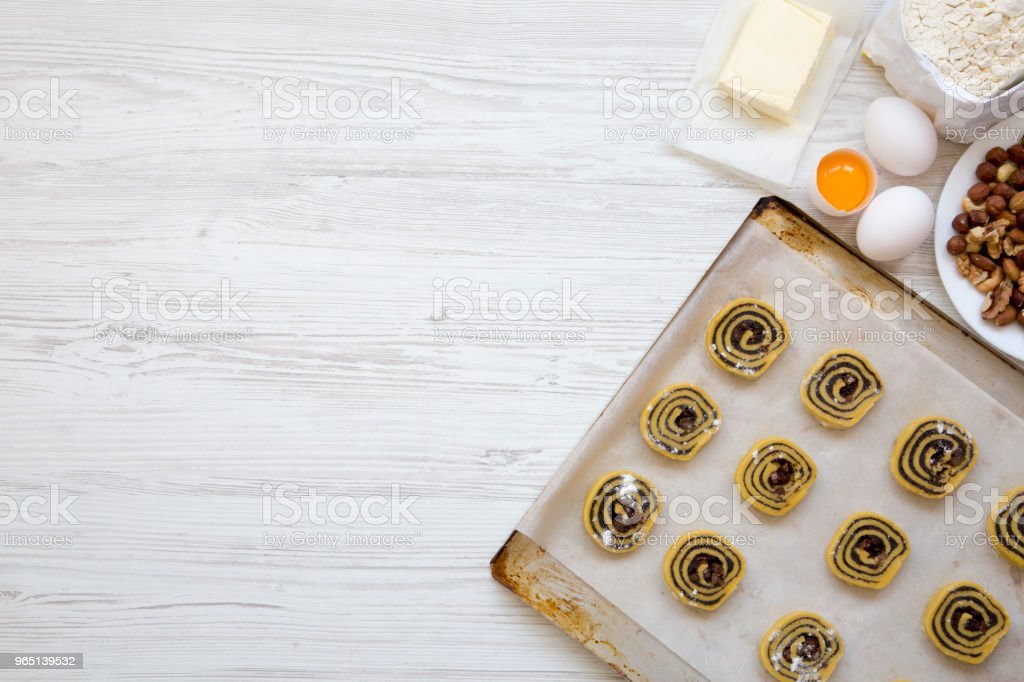 Unbaked cookies with ingredients for making cookies, top view. From above, flat lay. Copy space. royalty-free stock photo