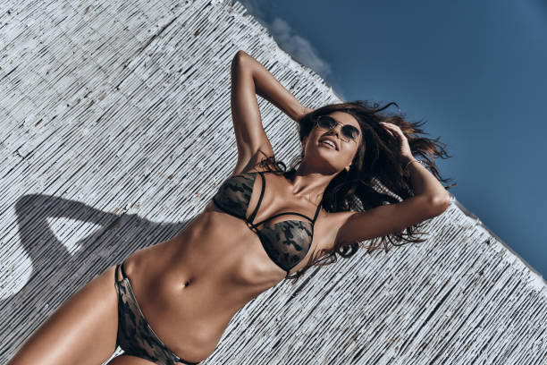 unbelievably beautiful. - busty women in bikinis stock pictures, royalty-free photos & images