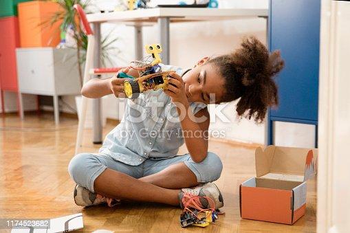 Cute girl unboxing robot