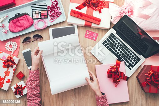 Female customer unboxing some beautiful gifts, online shopping, delivery and e-commerce concept