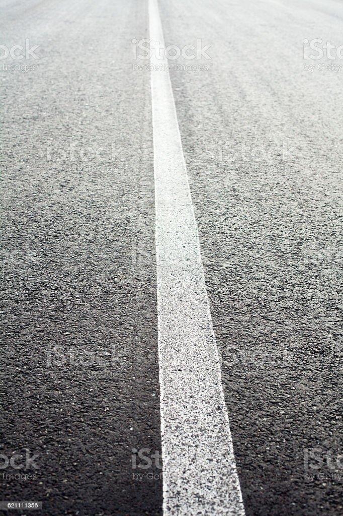 Unbroken white road marking line stock photo
