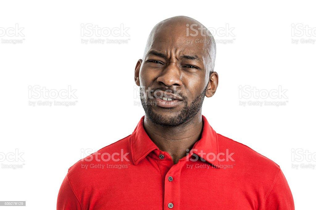 Uncertain black man portrait stock photo