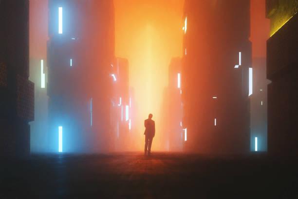uncertain businessman standing on the street at night - футуристический стоковые фото и изображения