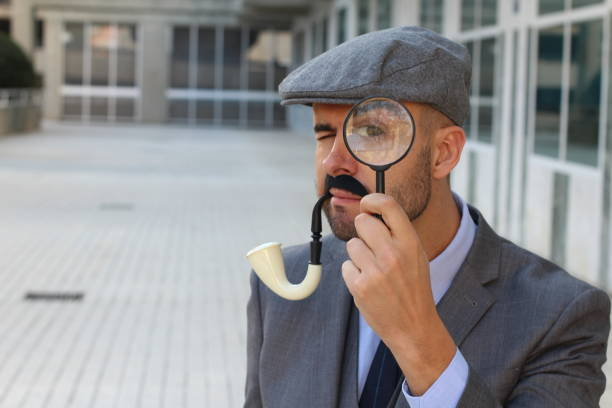 Uncertain detective figuring something out Uncertain detective figuring something out. sherlock holmes stock pictures, royalty-free photos & images