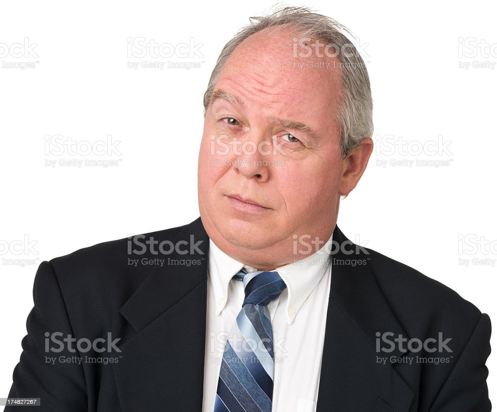 Uncertain Mature Man In Suit Raising One Eyebrow royalty-free stock photo