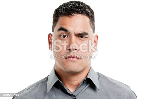 istock Uncertain Young Man Raises One Eyebrow 183582790