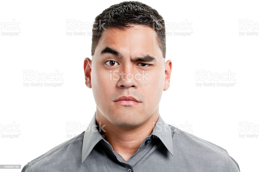 Uncertain Young Man Raises One Eyebrow stock photo