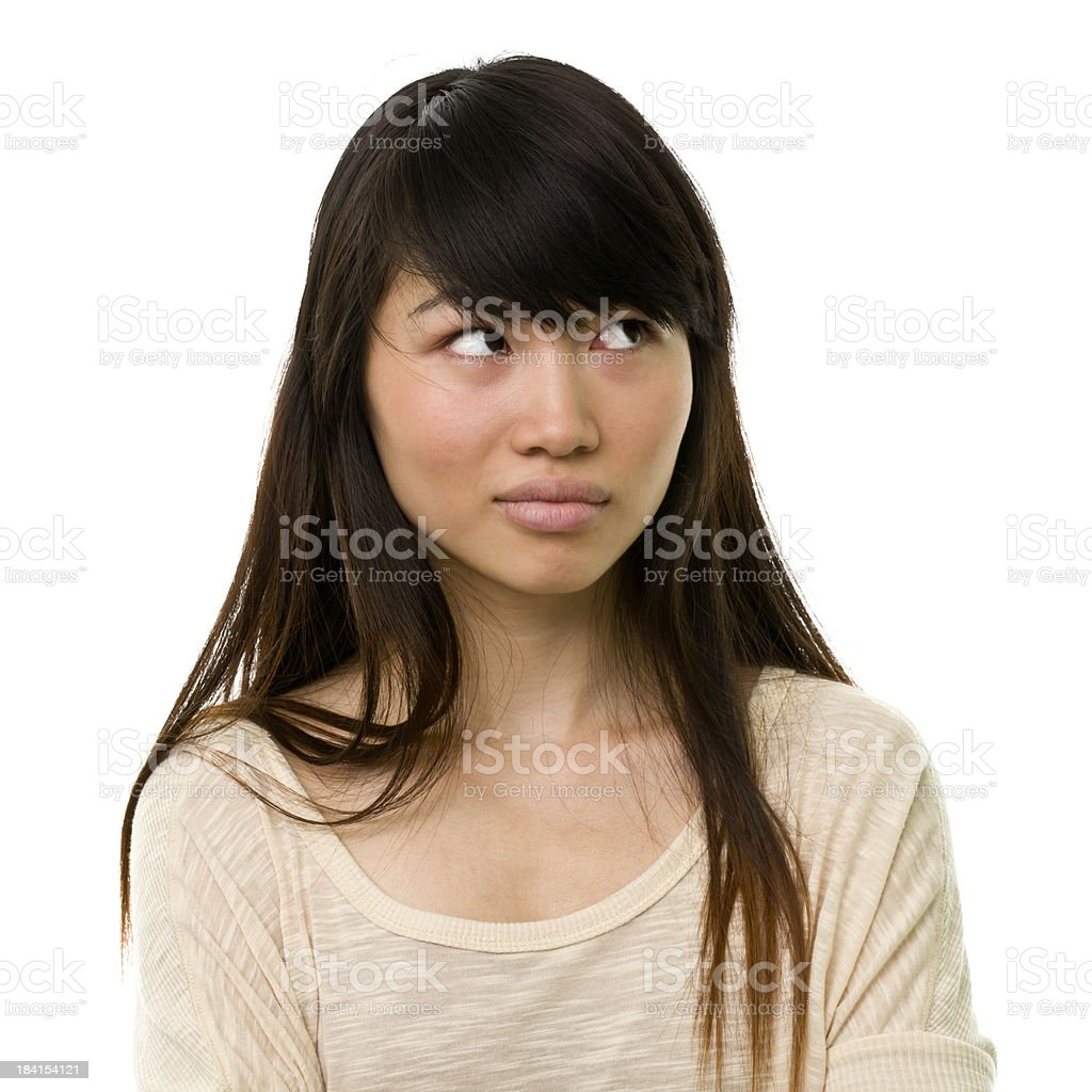 Uncertain Young Woman Looks Away stock photo