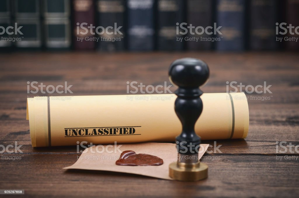 Unclassified document and notary seal on the wooden background. stock photo
