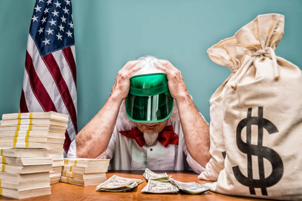 uncle sam as an accountant working on the us fiscal budget - frustrated - man face down stock pictures, royalty-free photos & images