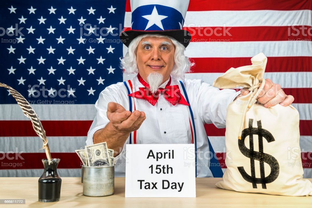 Uncle Sam collecting taxes on April 15th, tax day in the US stock photo