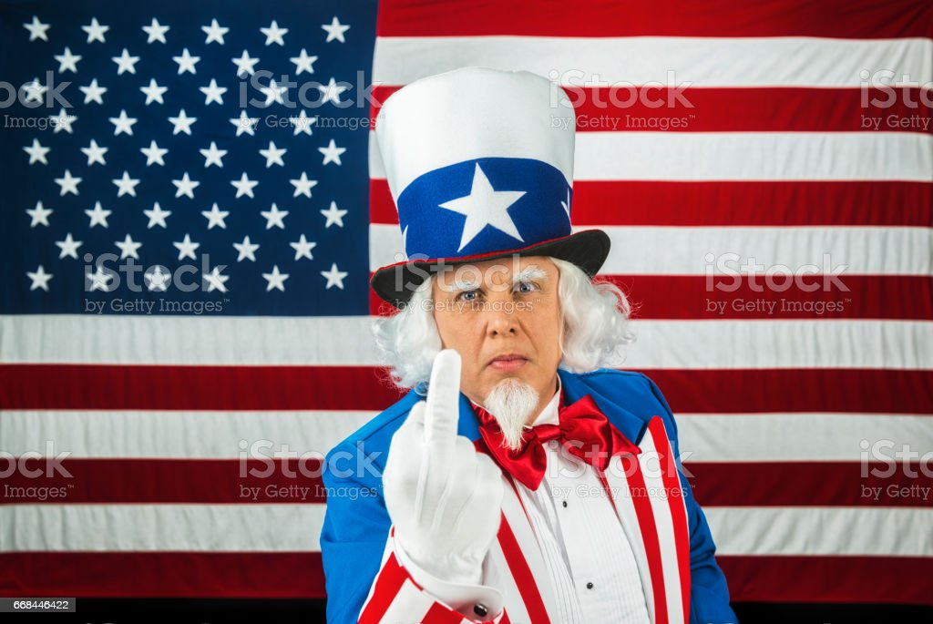Uncle Sam Giving The Middle Finger While In Front Of The Us Flag