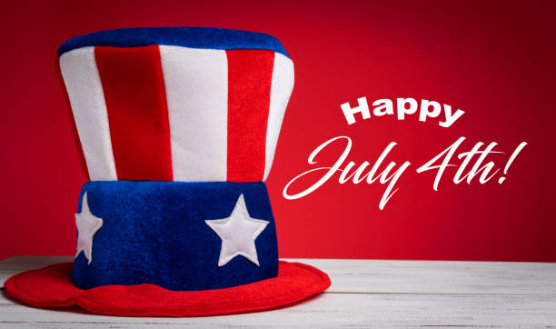 Uncle Sam hat on red background with Happy July 4th greeting stock photo