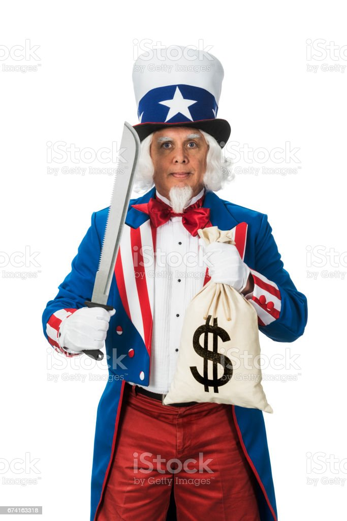 Uncle Sam holding a money bag and machete while standing against a white background, Concept - Drastic Budget cutting stock photo