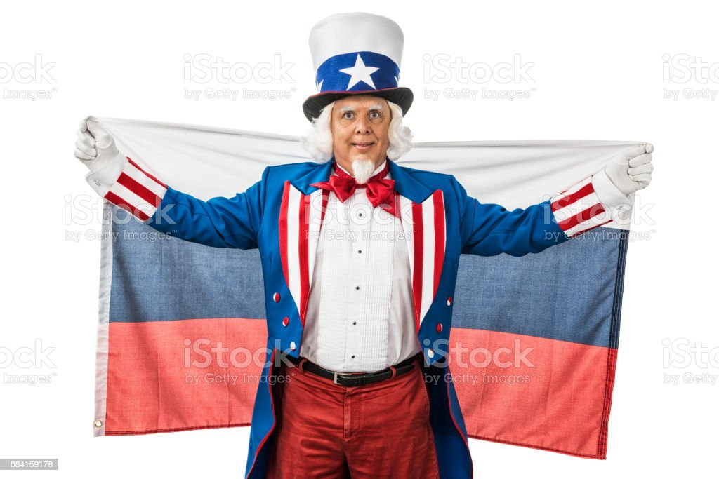 Uncle Sam holding up a Russian flag behind him zbiór zdjęć royalty-free