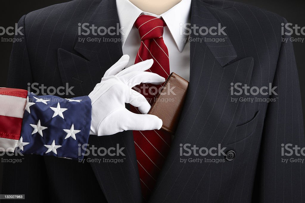 Uncle Sam picks businessman's pocket stock photo