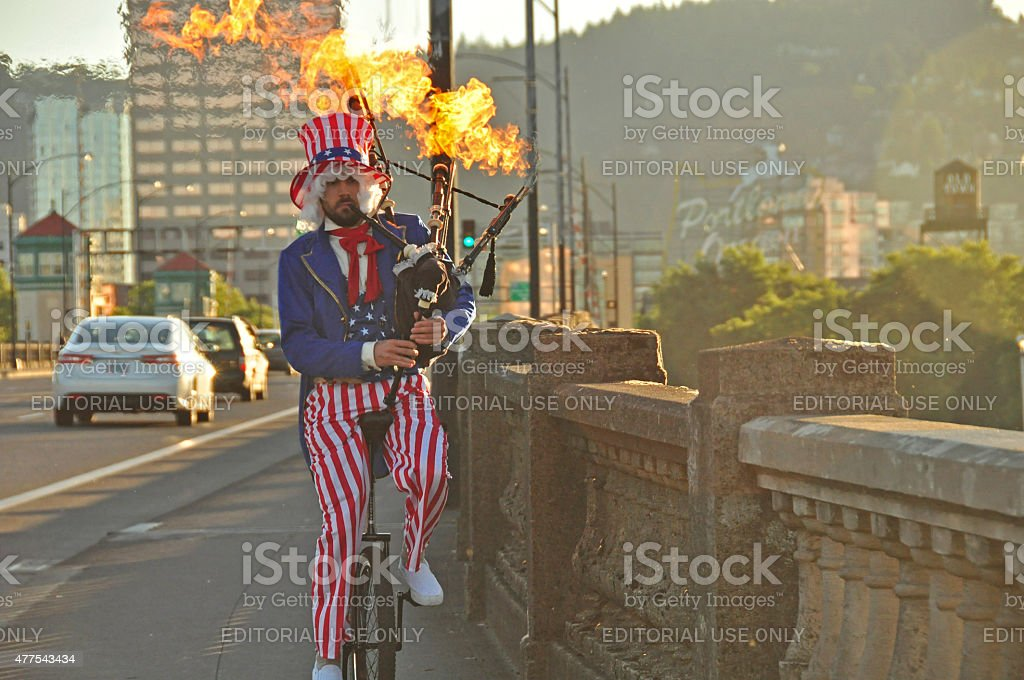 Uncle Sam Riding Unicycle and Playing Flaming Bagpipes in Portland stock photo