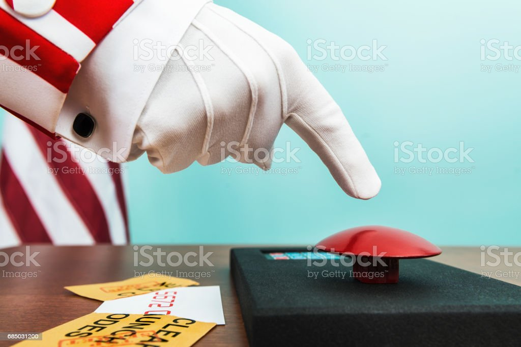 Uncle Sam 's finger poised over Nuclear Launch Button stock photo