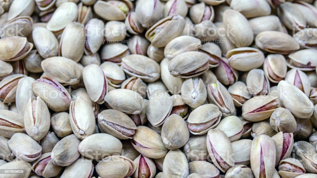 Uncleaned pistachio nuts stock photo