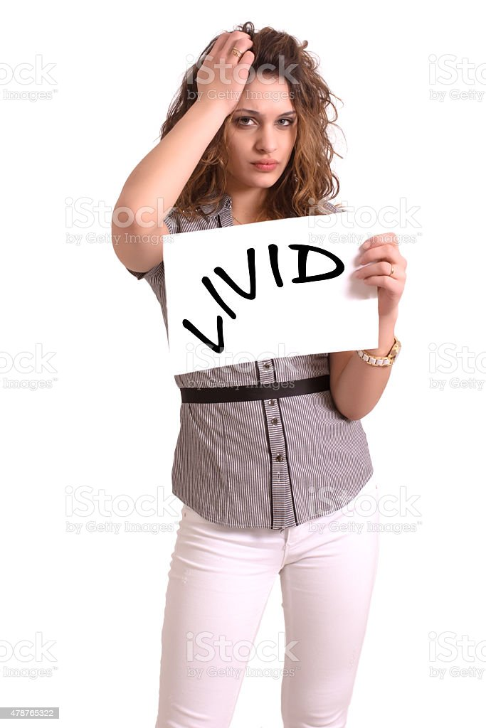 uncomfortable woman holding paper with Livid text stock photo