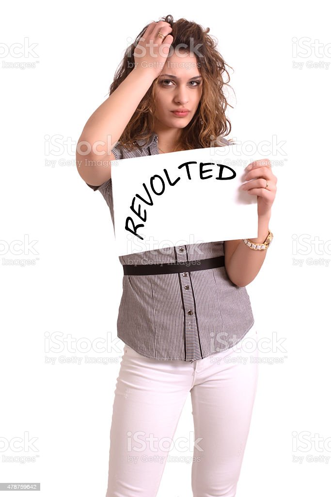 uncomfortable woman holding paper with Revolted text stock photo