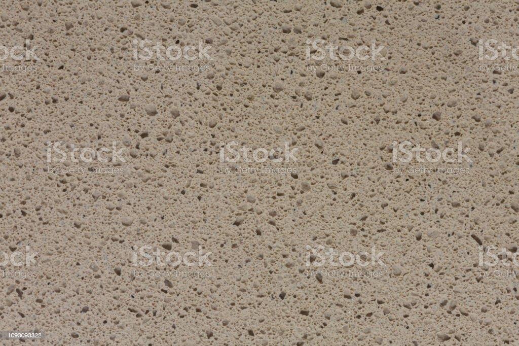 Uncommon nice grey synthetic stone background on macro.