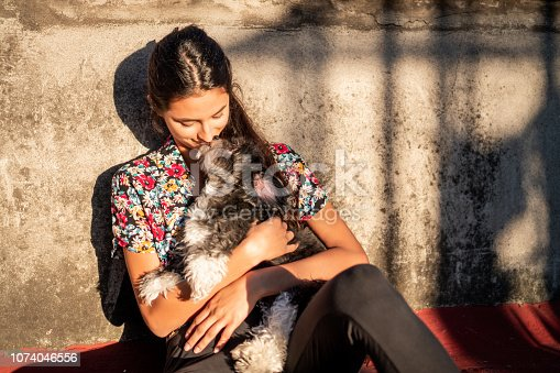 Beautiful woman relaxing on the sun with her dog