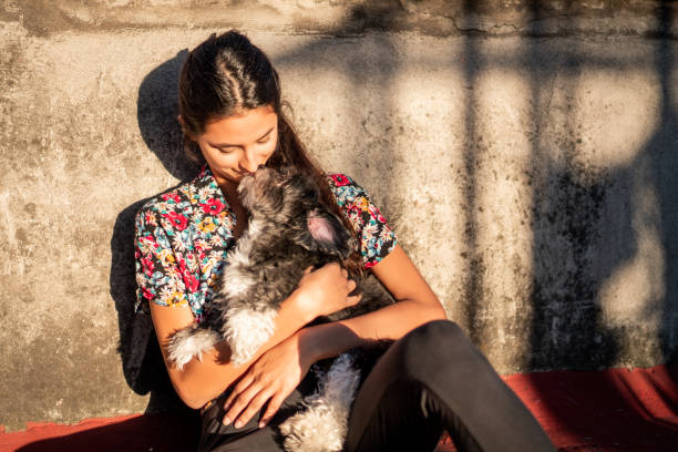 Unconditional love Beautiful woman relaxing on the sun with her dog alternative pose stock pictures, royalty-free photos & images