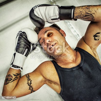 160558362 istock photo Unconscious Boxer to the Mat 521654143