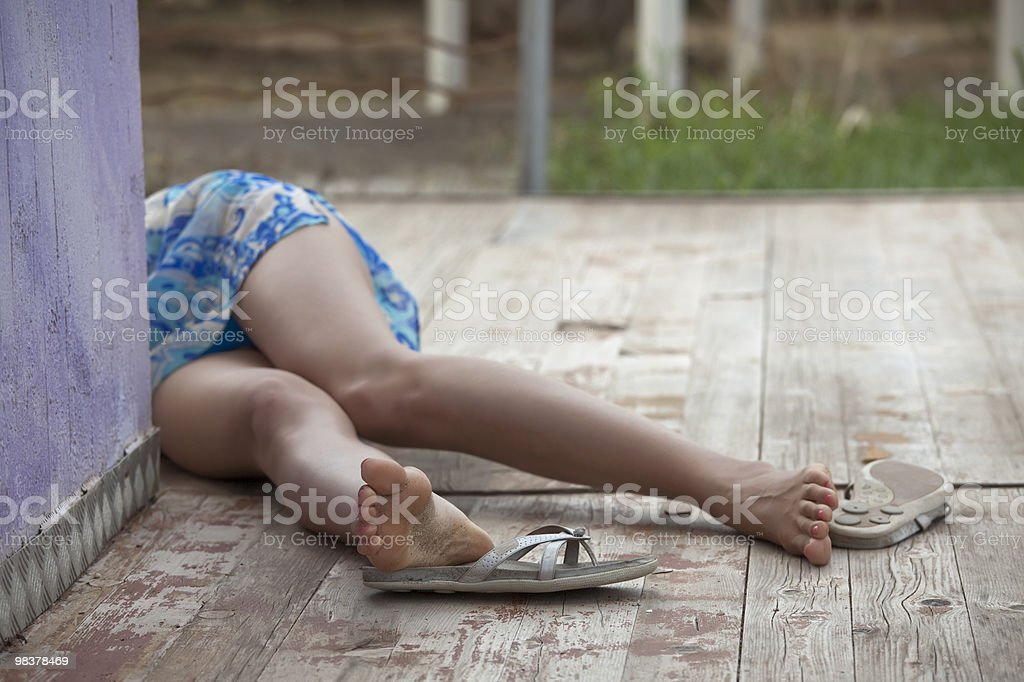 unconscious female victim stock photo