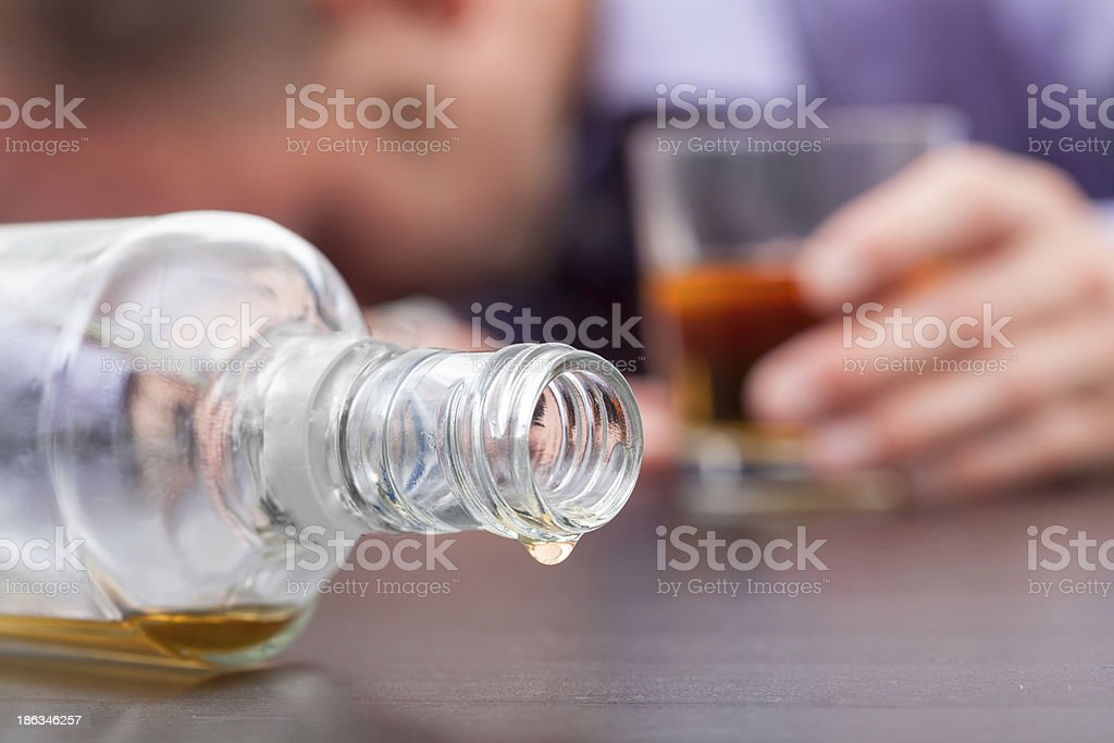 Uncontrolled consumption of alcohol stock photo