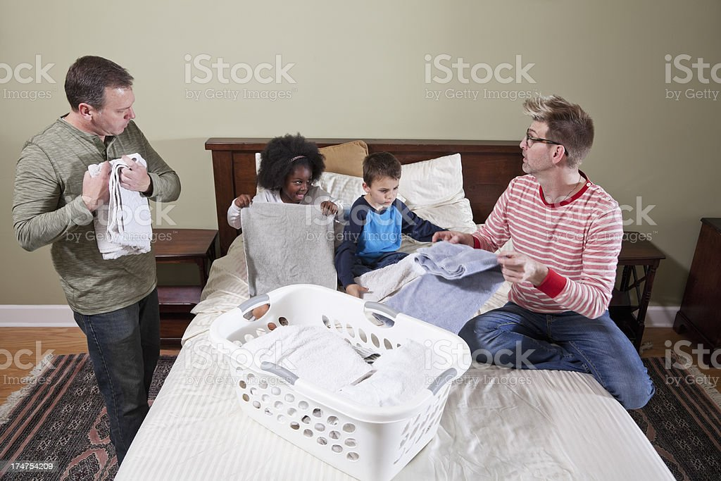 Unconventional family doing housework royalty-free stock photo