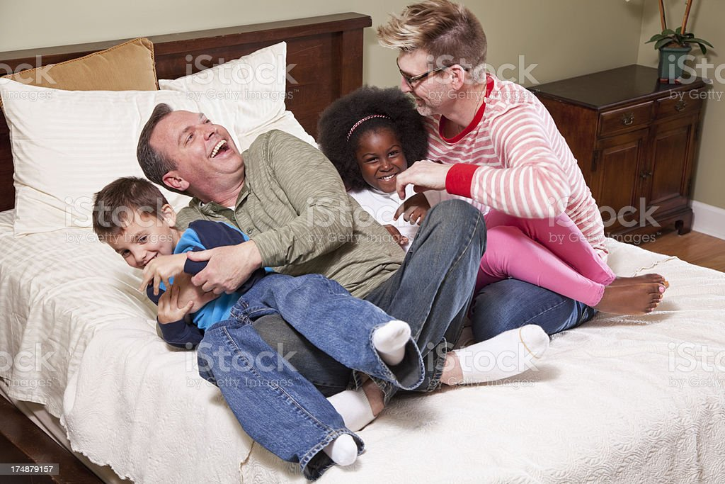 Unconventional family playing royalty-free stock photo