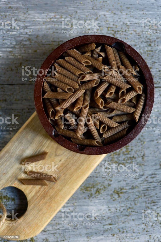 uncooked buckwheat penne rigate stock photo