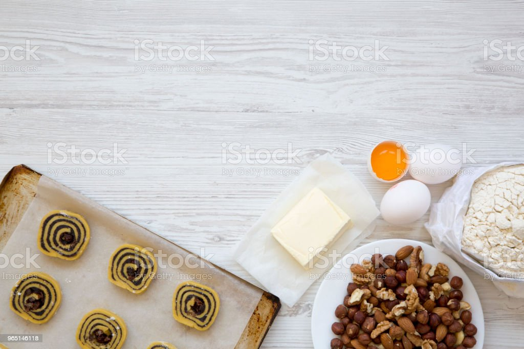 Uncooked cookies with ingredients. Top view, flat lay. Copy space. royalty-free stock photo