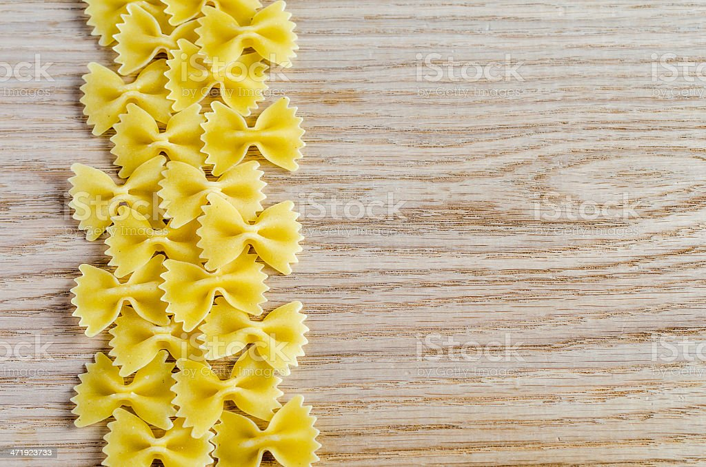 Uncooked farfalle pasta background stock photo