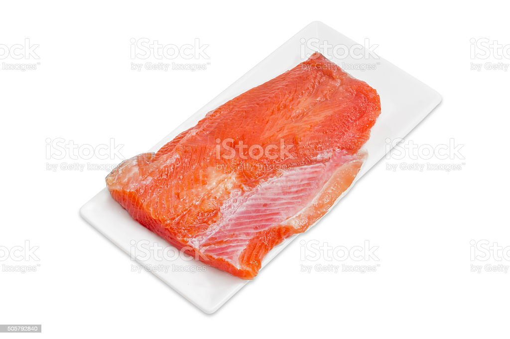 Uncooked fillet of rainbow trout on a rectangular dish stock photo