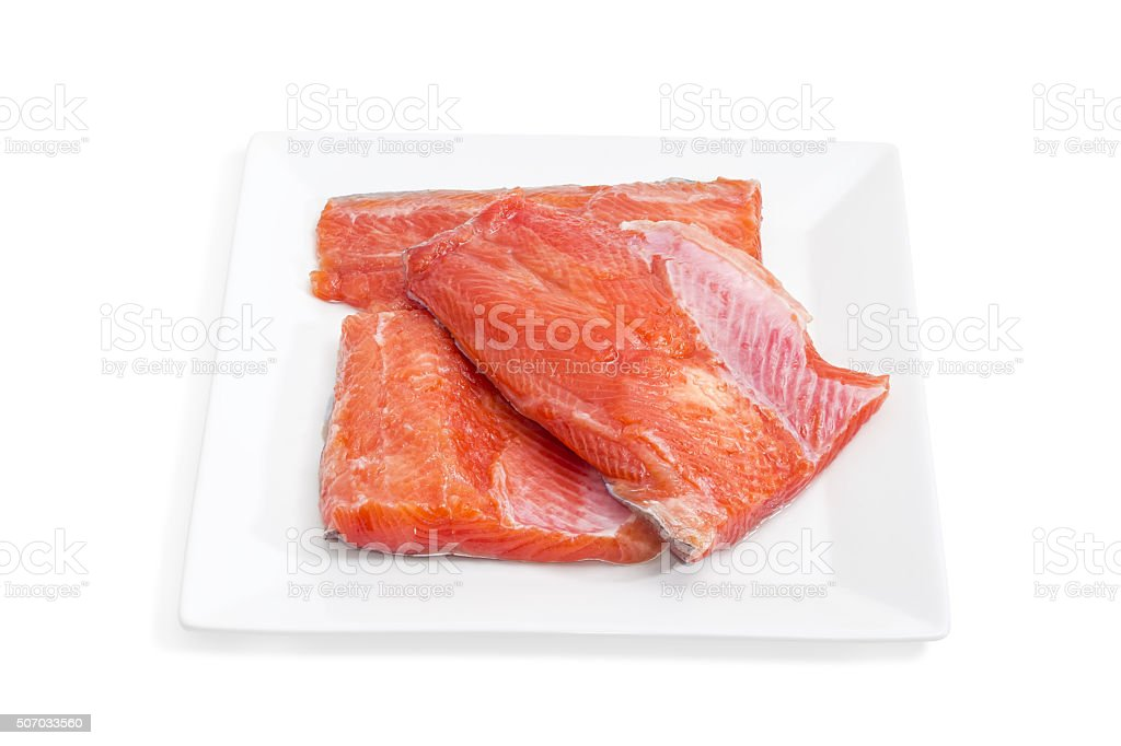 Uncooked fillet of rainbow trout on a square dish closeup stock photo