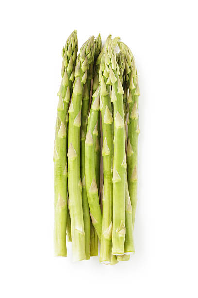 uncooked green asparagus from above, isolated on white stock photo