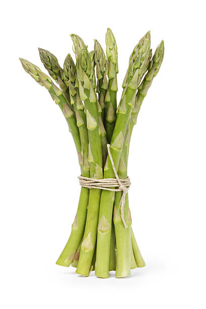 uncooked green asparagus tied with twine - asparagus stock pictures, royalty-free photos & images