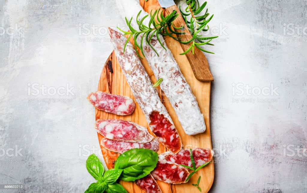 Uncooked jerked sausages stock photo