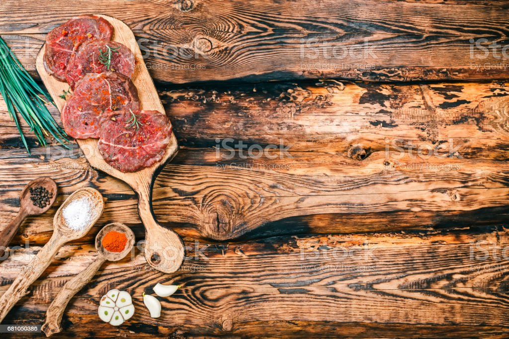 Uncooked meat on rustic wood royalty-free stock photo