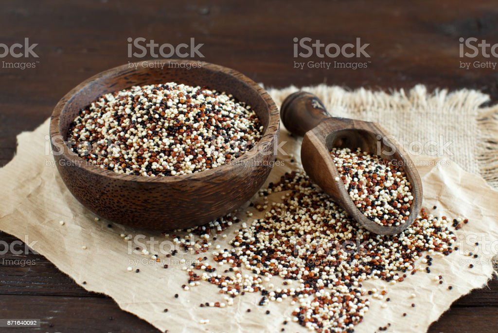Uncooked mixed quinoa grain in a bowl stock photo