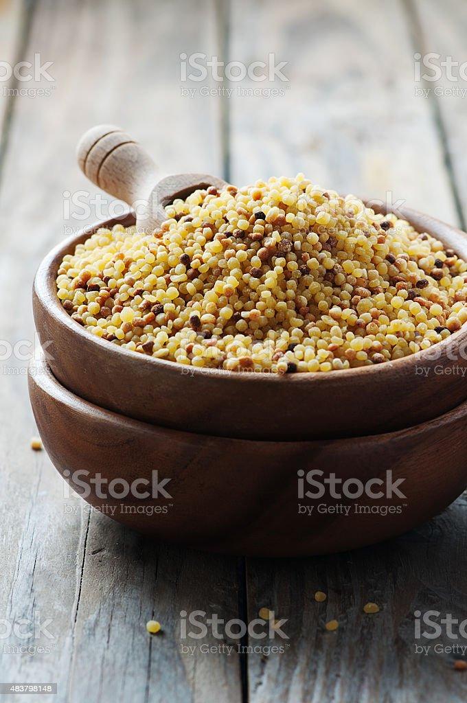 Uncooked sardinain pasta fregola stock photo