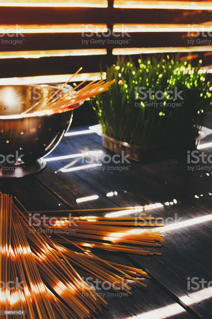 Uncooked spaghetti on a wooden table royalty-free stock photo