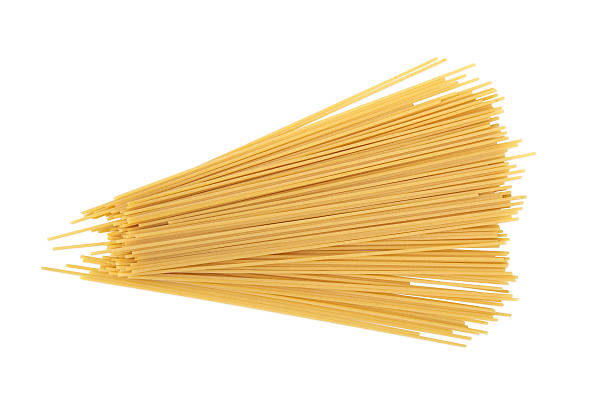 Uncooked Spaghetti Uncooked spaghetti isolated on white background uncooked pasta stock pictures, royalty-free photos & images