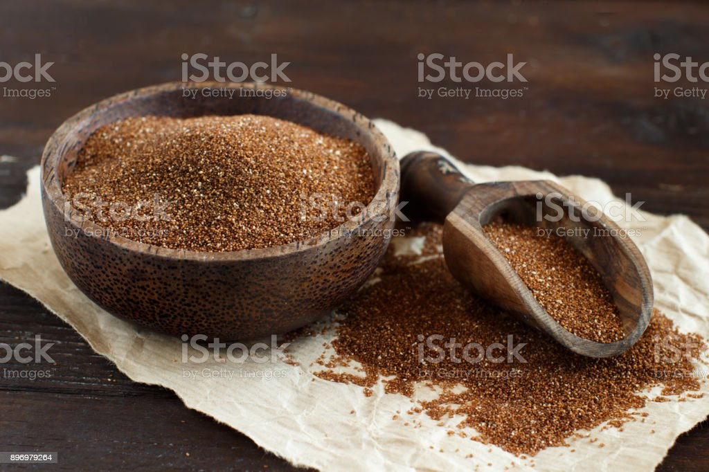 Uncooked teff grain in a bowl stock photo