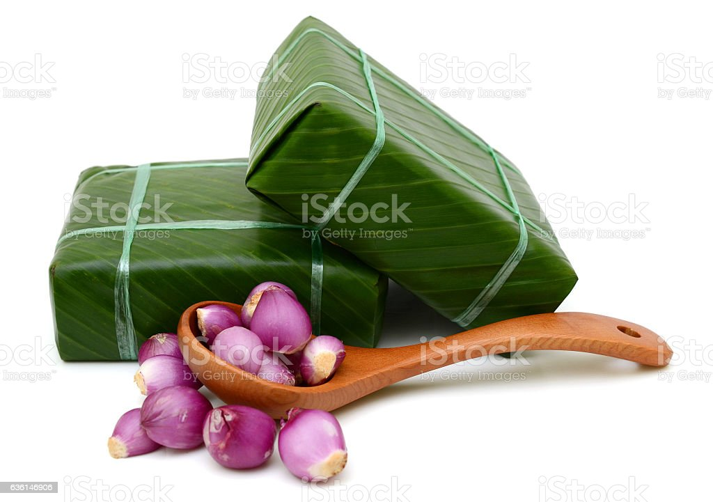 Uncooked Vietnamese Chung Cake isolated on white stock photo